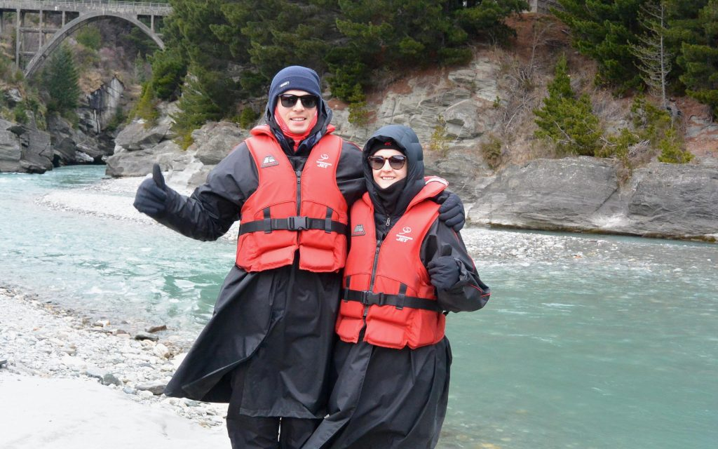 Max and Lizzie wearing lots of coats, waterproofs and life jackets before going on the Shotover Jet in Queenstown, NZ.
