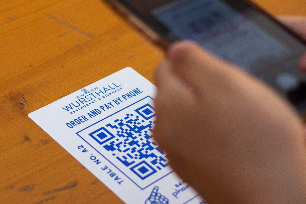 Image of a phone scanning a QR code